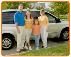photo of a family in front of a minivan